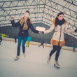 Two girls on ice-skating rink — Stock Photo #63291889