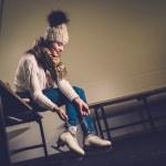 Girl putting on skates  in locker room — Stock Photo #63291911