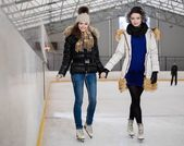 Two girls on ice-skating rink — Stock Photo