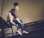 Girl putting on skates  in locker room — Стоковое фото