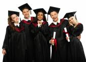 Multi ethnic group of graduated students — Stock Photo
