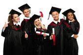 Multi ethnic group of graduated young students — 图库照片