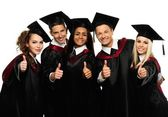 Multi ethnic group of graduated young students — Fotografia Stock