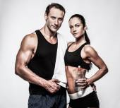 Athletic couple after fitness exercise — Stock Photo