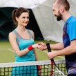 Woman tennis player shaking hand with her coach — Stock Photo #65292255