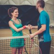 Woman tennis player shaking hand with her coach — Stock Photo #65292309