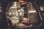 Motorcycle carburetor with custom made air filter box — Stock Photo