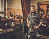 Mechanic in motorcycle custom garage — Stock Photo