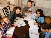 Students preparing for exams in home interior — Stock Photo