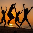 Silhouettes a young people jumping on a beach    — Stock Photo #68252707