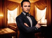 Sharp dressed dandy fashionist in luxury apartment interior  — Stock Photo
