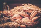 Basket with homemade baked goods on a table — Stock Photo