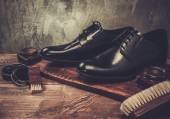 Shoe care accessories on a wooden table  — Stock Photo