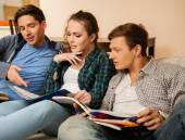 Three students preparing for exams in apartment interior  — Stock Photo