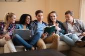Group of multi ethnic young students preparing for exams in home interior  — Stock Photo