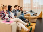 Group of students preparing for exams in apartment interior  — Stock Photo