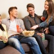 Group of cheerful students with drinks and popcorn — Stock Photo #68909761