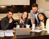 Group of cheerful students preparing for exams  — Stock Photo