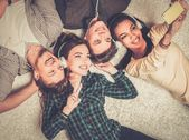 Happy multiracial friends taking selfie — Stock Photo