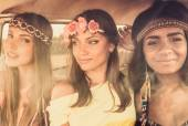 Multinational hippie girls in a van — Stock fotografie