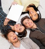 Happy multiracial friends taking selfie with tablet pc  — Stock Photo