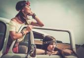 Hippie girls in a van on a road trip — Stock Photo