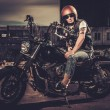Biker and his bobber style motorcycle on a city streets  — Stock Photo #70888873