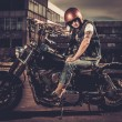 Biker and his bobber style motorcycle on a city streets  — Stock Photo #70888877