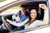 Happy driving student with a car keys — Stock Photo