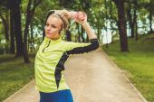 Woman doing stretching exercise before running — Stock Photo
