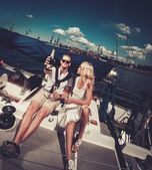 Stylish wealthy couple on a yacht  — Foto de Stock