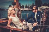 Wealthy couple on a luxury yacht — Stock Photo