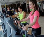 People exercising on a cardio training machines — Stock Photo