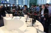 HANNOVER, GERMANY - MARCH 13: The stand of DJI on March 13, 2014 at CEBIT computer expo, Hannover, Germany. CeBIT is the world's largest computer expo — Zdjęcie stockowe