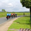 A group of cyclists on the road — Stock Photo #73645319