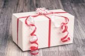 White gift box with a small bow — Stock Photo