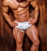 Bodybuilder psoing in the studio. — Zdjęcie stockowe
