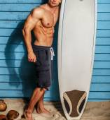 Studio shot,surfer and his swimming deck — Foto Stock