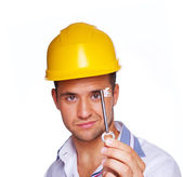 Portrait of sexy worker posing in studio with key — Stock Photo