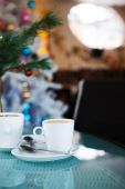 Cup with coffee in the Restourant.Christmas time. — Stock Photo