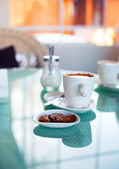 Delicios Coffee and some sweets — Stock Photo
