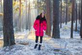 The girl on a walk in the winter wood — Foto Stock