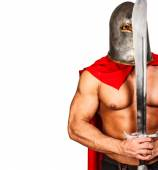 Calm warrior with a sword close to his face — Stock Photo