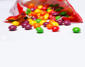 Openned pack with skittles in it — Stock Photo