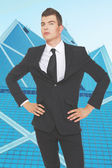 Well looking young businessman in front of skyscraper — Stock Photo