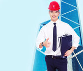 Successful young guy in a hardhat  — Stock Photo