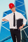 Young nice guy in hardhat with a folders  — Stock Photo