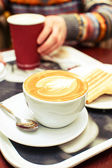 Coffee cup and pancakes on the table — Stock Photo