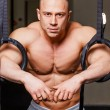Strong muscular man bodybuilder — Stock Photo #62585419