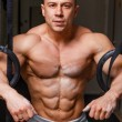 Strong muscular man bodybuilder — Stock Photo #62585515